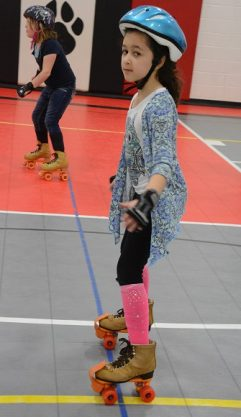Indian Creek students rollerskating during PE class.