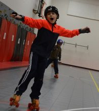 Indian Creek student rollerskating in PE class.