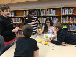 A group of Indian Creek students working on their lemon batteries