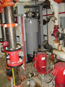 Replace a boiler and HVAC unit at the High School