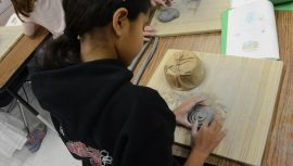 Indian Creek student working ith clay in art class.