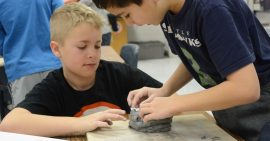 Indian Creek students working together to create a clay project in art class.