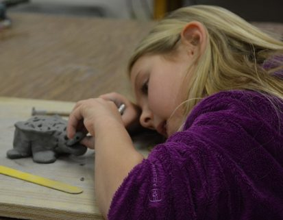 Indian Creek student creating her clay turtle in art class.
