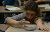 Indian Creek student working with clay in art class.