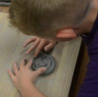 Indian Creek student working on a clay project in art class.