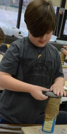 Indian Creek student working with clay in art class