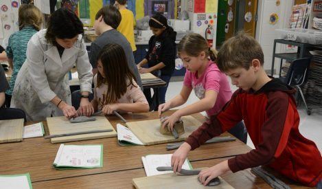 Indian Creek students in art class working on their clay projects.
