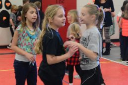 three friends dancing during the Indian Creek dance marathon.