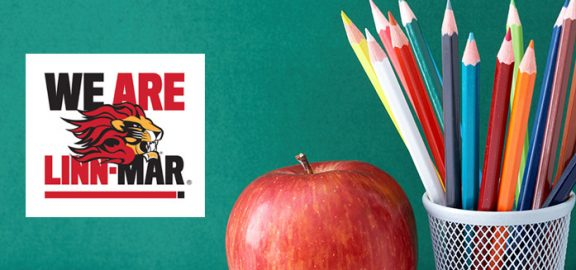 We Are Linn-Mar News - image of crayons and red apple against blackboard