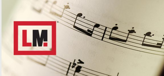 Linn-Mar - L-M logo - musical notes on page
