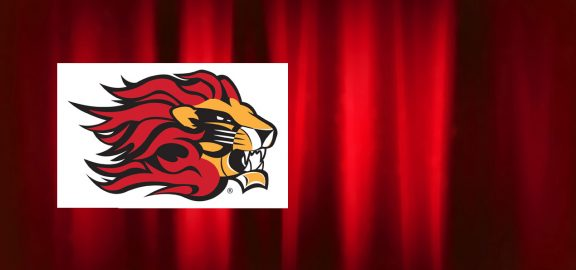 Lion head logo over red curtain