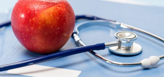 healthcare-red-apple-and-medical-stethoscope-healthy-lifestyle