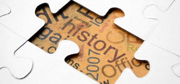 The word history on a puzzle piece