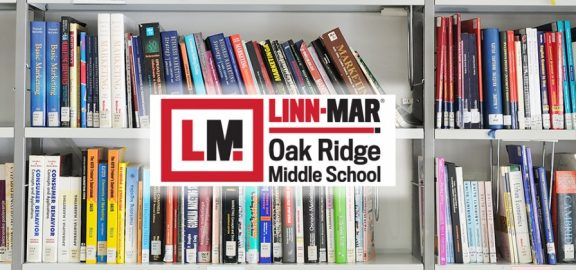 Oak Ridge Middle School logo in front of library book son shelf