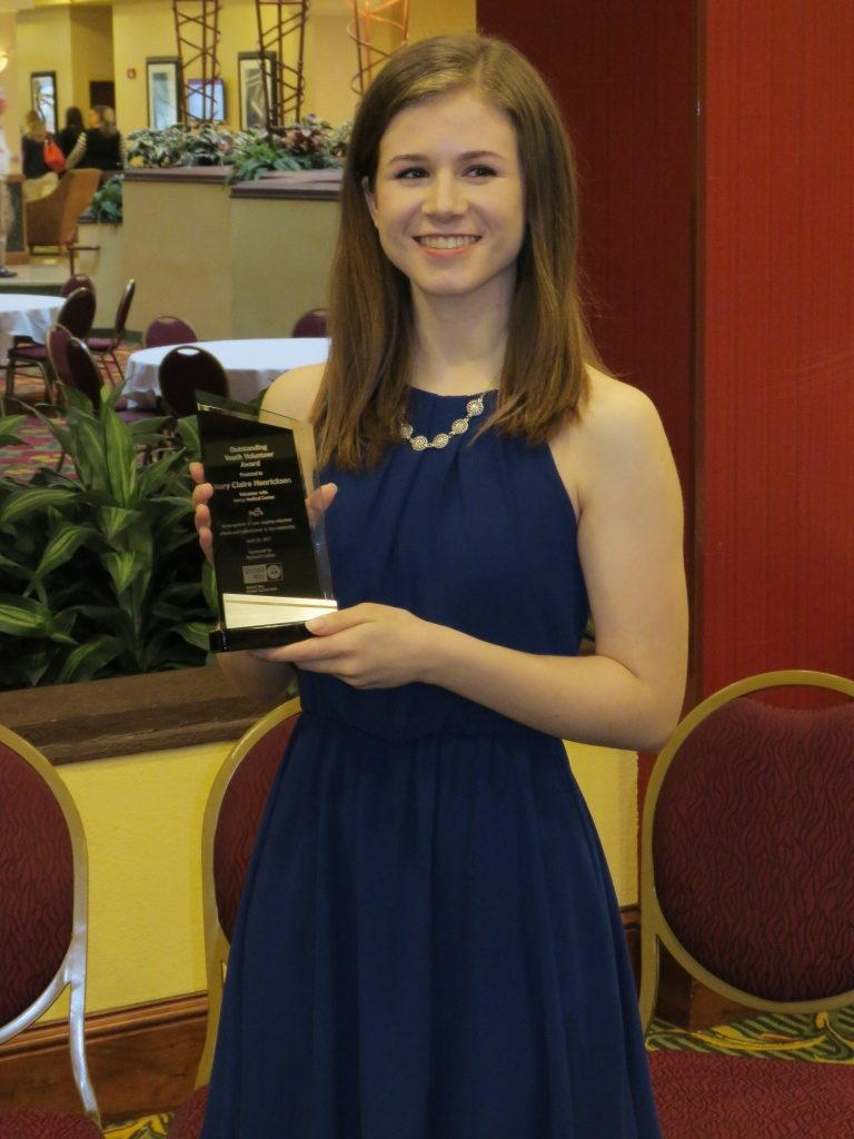 Senior Mary Claire Henricksen displays her United Way of East Central Iowa Youth Volunteer Award.
