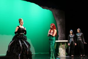 Student perfroming spring musical at Linn-Mar High School