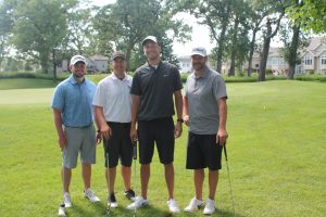 2016 Annual Lion Open Golf Classic - group photo of four Linn-Mar staff