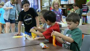 Students holding bags of homemade slime
