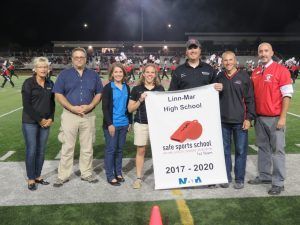Representatives from UnityPoint Health present Linn-Mar representatives with the 2017-2020 Safe Sports Award. Pictured (left to right) are: Denise Walker, Dr. Thomas Richmann, and Carol Schueller from Unity Point-St Lukes and Athletic Trainers Marissa Yorgey, Vince Klopfenstein, Superintendent Quintin Shepherd and Athletic Director David Brown from the Linn-Mar Community School District.