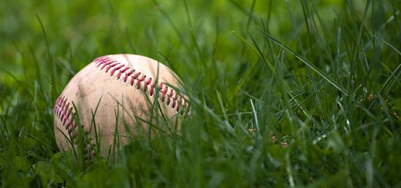 baseball laying on a grass field