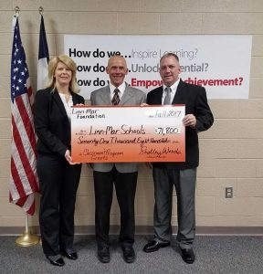 Linn-Mar Foundation members present the Linn-Mar superintendent with a large-sized check