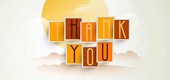 the words thank you in front of clouds and sun in fall colors