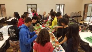 ALO sudents at Linn-Mar High School prepare Care packages for the the Marion PD
