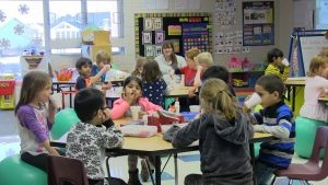 Students drinking hot chocolate while listening to the Polar Express
