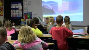 Children watching pictures of polar express on screen