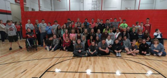 Linn-Mar High School students in the clubs Students Opposed to Drugs and Alcohol and Teens Reaching Youth gather for a group photo