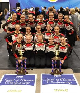 Linn-Mar High School Varsity poms and 1st place trophies from regional competition