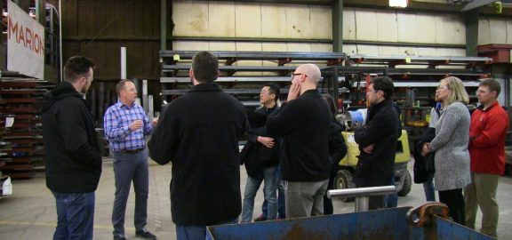 A group of Linn-Mar High School teachers tour the shop area of Marion Legacy Manufacturing