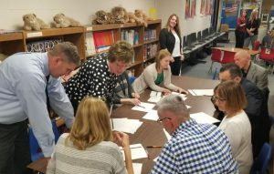 Group exercise during school board meeting