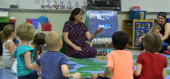 Teacher leads students at Story time