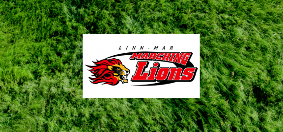 Marching Lions logo over grass