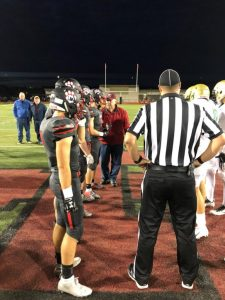 Coin Toss midfield at football game