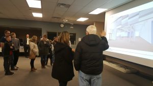 Guests watching slides at Intermediate Open house