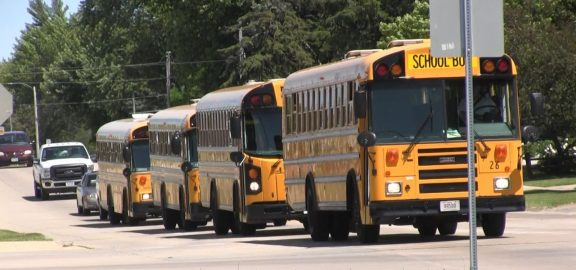 Linn-Mar school buses at stop sign
